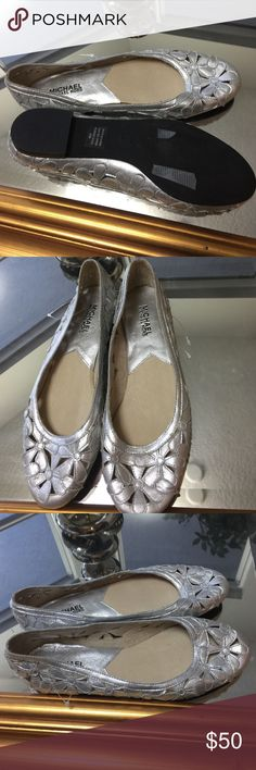 Leather Michael Kors flats!!!!! Almost new! Silver Michael Kors flats! Maybe worn once because they didn't fit well I took them off and changed shoes. (Too small for my wife foot) KORS Michael Kors Shoes Flats & Loafers