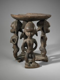 Culture: Limba Culture: Baga Culture: Bassa Stool Supported by Four Male and Female Figures Figures  early 20th century Wood, iron, pigment