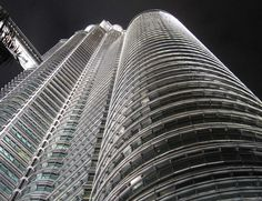 The awesome Petronas Towers in Malaysia, shot by night.