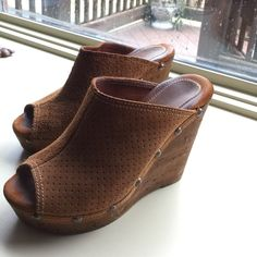 """💥Gorgeous Camel Leather Sbicca Wedges💥 🎀Camel Colored Leather Sbicca Wedges🎀 Gorgeous pair of shoes that go with so many outfits! Extremely well made and easy to walk in. The camel leather upper is attached to the Soft Wood Wedge with Bronze Studs. Wedge Height-4 3/4"""" Platform Height-1 1/4"""" EXCELLENT CONDITION Size on shoe says 39, but these fit like an 8. Sbicca Shoes Wedges"""