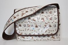 Laminated messenger bag with padded interior...change dimensions and add camera inserts....