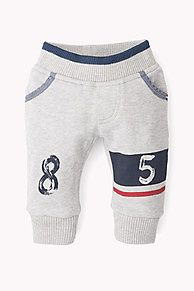 Super soft and comfortable jogging trousers with a broad, elasticated waistband and the Hilfiger Denim '85' logo across the knees. Made from a soft cotton-polyester blend with a brushed French terry inside for added warmth.