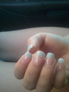 Prom nails, white tipped acrylic nails.  Painted clear coat, sprinkled silver glitter.  Dusted fingers and applied a top coat over the whole nail.  Pretty!