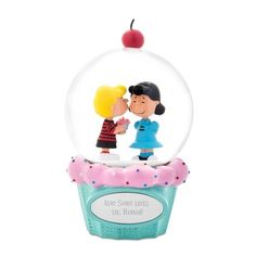The personalized Peanuts Schroeder and Lucy Cupcake Snow Globe is perfect for any fan of the classic comic strip. Designed exclusively for Things Remembered, this artfully detailed snow globe features an affectionate Schroeder and Lucy surrounded by confetti snowflakes. Engrave the cupcake-shaped base with a name and special message.  https://www.thingsremembered.com/product/Peanuts-Schroeder-and-Lucy-Cupcake-Snow-Globe/178788.uts
