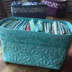 these quilted fabric baskets are made from on basic basket pattern and made into the prettiest baskets. Just right to store fabric