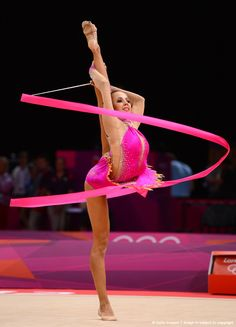 Daria Dmitrieva of Russia competes with the ribbon during the Individual All-Around Rhythmic Gymnastics final on Day 15 of the London 2012 Olympics Games at Wembley Arena on August 2012 in London, England. Olympic Gymnastics, Olympic Sports, Gymnastics Girls, Rhythmic Gymnastics, Olympic Games, Gymnastics Music, Gymnastics History, Gymnastics Flexibility, Female Dancers