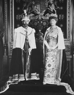 King George V and Queen Mary of the United Kingdom dressed for the coronation in one of the rooms of the House of Parliament. George wears the Imperial State Crown and Order of the Garter, while Mary wears the Delhi Durbar Tiara, Necklace, Stomacher and other jewels. 1911.