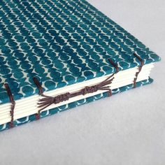 Create a Stunning Combination Coptic Long-stitch Archival Book – Crafts & DIY – Tuts+ Tutorials A really good tutorial, shows how to add the reef knots on the long stitches Mini Albums, Arte Steampunk, Homemade Books, Bookbinding Tutorial, Stitch Book, Handmade Journals, Handmade Notebook, Paper Book, Book Binding
