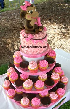 - Cake and Cupcake Tower for a little girl's first birthday party!
