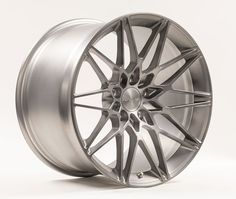 One of 8 new Forgeline wheels that will debut at the 2015 SEMA Show, the 1pc forged monoblock MT1, shown here in the new Matte Transparent Smoke finish, features a ten spoke mesh design, unique deeply-cut diamonds machined into the base of each spoke around the center of the wheel, deep concave profile, & radically-chamfered outer edge. Learn more about the MT1 (including sizes & pricing) at: http://www.forgeline.com/products/one-piece-monoblock/mt1.html  #Forgeline #monoblock #MT1…