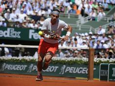 RG13 - Rafa Nadal chases down a ball to hit a successful tweener. ©FFT