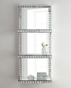 "$395 on sale.  Mosaic-Border Mirrored Shelf Wall Panel at Neiman Marcus.  17.5"" wide x 43"" tall x 7.5"" deep"