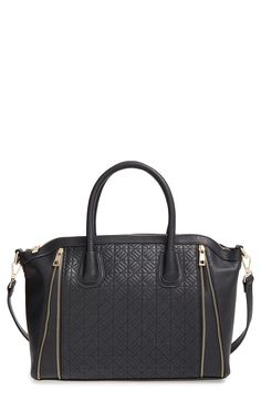Decorative zipper details and a quilted front panel make this spacious satchel a versatile and sophisticated style staple.