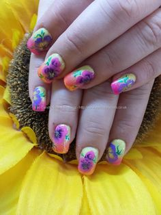 Multicoloured gel polish with freehand one stroke flower nail art