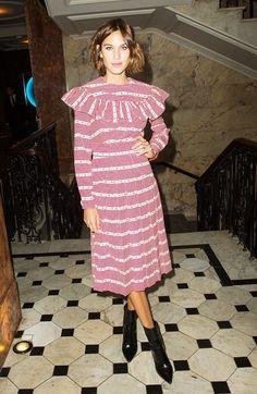 Alexa Chung wears a striped Miu Miu dress with black boots