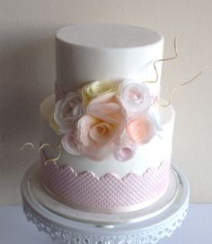 Delicate Wafer flowers adorn this 2-tier cake.