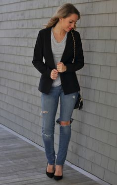 Think you can't wear ripped jeans to work? Think again! If you have a creative office or one with a relaxed dress code, just throw on a structured blazer to make your look pulled together and work appropriate.