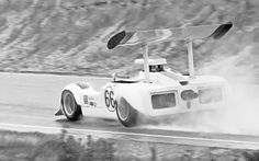 Jim Hall feels out the track during the pre-race warm-up for the 1968 Laguna Seca Can-Am. Hall had qualified 2nd, but a broken starter would result in the car not starting the race and being pushed off the grid. John Cannon would win in a three year-old McLaren, the only car fitted with F1 rain tires. A John Lacko photo. New Sports Cars, Sports Car Racing, Race Cars, Can Am, Le Mans, Golden Age, Corvette, Cool Cars, Lotus
