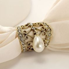 This Gold Crystal Filigree Pearl Pendant Scarf Ring features handcrafted filigree and crystal decorative hollow out bell shaped ring with pearl pendant used for clasping the silks, scarfs, curtains and the alike. Pearl Brooch, Brooch Pin, Pearl Earrings, Collar Tips, Scarf Rings, Pearl Pendant, Lapel Pins, Filigree, Napkin Rings
