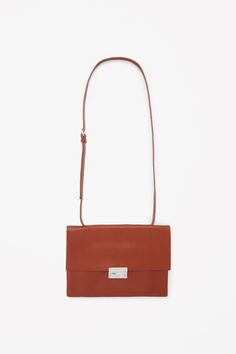Made from lightly grained raw-cut leather, this shoulder bag fastens with a shiny metal clasp on the front. Unlined, it has two simple interior compartments and can also be worn as a clutch by removing the adjustable leather strap. Minimalist Bag, Work Tote, Best Bags, New Bag, Handbags On Sale, Bag Sale, Fashion Brand, Leather Bag, Purses And Bags