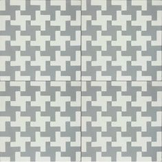 Aberdeen grey.  A modern take on the classic houndstooth...in cement tile.