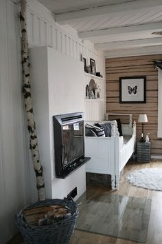 The room has too many hard angles and surfaces for me, but I love the butterfly print and that birch tree!