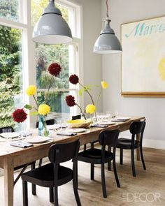 The kitchen dining area features vintage lamps from the Rover car factory.  Photographer: Simon Upton