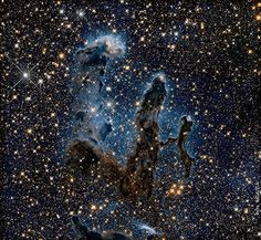 The Pillars of Creation photographed in near-infrared light, better showing the formation of stars. Photo: NASA.