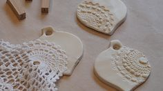 Holiday ornaments made with clay and embossed with doilies, stamps, etc.