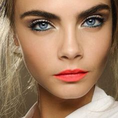 Bright coral lips, blue eyeliner for the summer