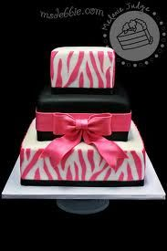 I like the cake but I would like the zebra stripes and bow to be purple and the white background be black and the black center could be purple. I want this for my birthday!!