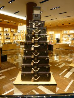 Louis Vuitton luggage display - I'll have one in every size.