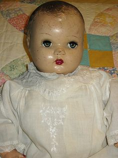 Horsman doll wearing vintage baby gown