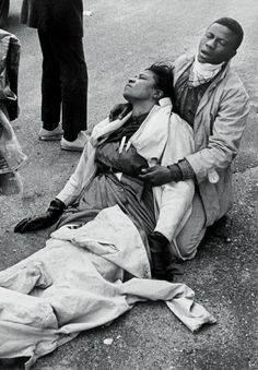 Amelia Boynton Robinson after she was beaten by state troopers on the Edmund Pettus Bridge in Selma Alabama (1965) [711 x 1024]