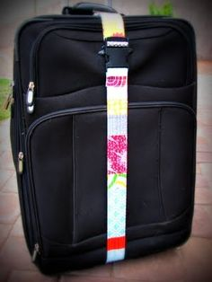 Luggage Strap.  Make just as you would a dog/cat collar but on a longer scale to go around your suitcase.   You can buy the buckles at craft stores or on sites like ebay and other online craft sites.   What a cool idea! Great way to ID your bag at just a glance!