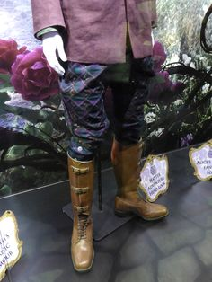 Close up of the pants and boots that Johnny Depp wears as the Mad Hatter. This costume is listed as the Hatter Adventure Hero look in Disney's Alice through the Looking Glass. From Hollywood Movie Costumes and Props.