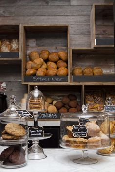 Little Goat Bread Cafe, Chicago, IL. I like the way they display the bread in the boxes at the back and the cookies etc in the glass domed jars on the counter.