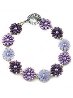 """Pretty posies to surround your wrist. The pretty posies in these perfectly precious bracelet kits are great for the young as well as the young at heart. Select your color and you're ready to start a bracelet that will go with anything from jeans and a T-shirt to an elegant dress. Finished size fits up to an 8 1/2"""" wrist. Kit includes SuperDuo beads Size 11/0 seed beads 4mm pearls Size 12 beading needles Clasp Complete, full-color instructions"""