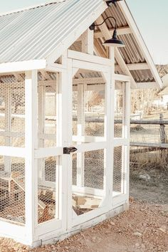 Gorgeous chicken coop design ideas, complete with tin roof, board and batten, a dutch door and stylish outdoor solar lights! Farmlife