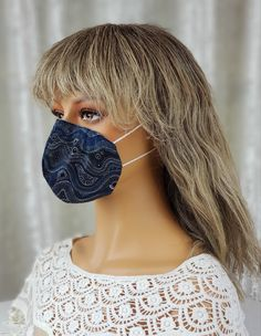 This new design 3 layer #covidmask is designed to be as #cool as possible for the summer months, light but effective. It fits perfectly around your nose and mouth but leaves the sides of your face open. Perfect for those who have to wear a mask to work and don't have the luxury of air conditioning in their workplace. The mask has an outer layer of quilting fabric, an inner layer of non-woven interfacing and a lining of light cotton. #covidmasksforsale Steampunk Hat, Half Mask, Steampunk Accessories, Masks For Sale, Quilting Fabric, Cotton Lights, Summer Months, Conditioning, Workplace