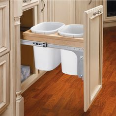 Rev-A-Shelf Top Mount Wood Double Bin Pull-Out Waste Containes with Zinc Slides - 2 x 10 Qt. (2 x 2.5 Gal.) on sale with free shipping at KitchenSource.com.