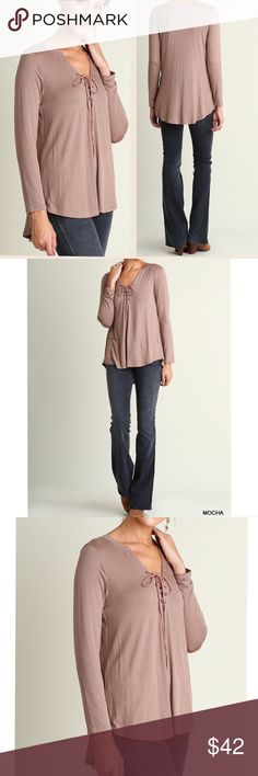 """🆕 ARRIVAL! Mocha v neck top with from tie detail Cute lace up V-neck High low long sleeve top Pair with skinny jeans or leggings for a trendy look.  Material: 65% cotton, 35% polyester ( always follow washing instructions) Lace up front detail High low hem  Measurements:  Small: Armpit to Armpit: 19.5"""" Length front and back: 27.5"""" and 31""""  Medium: Armpit to Armpit: 20"""" Length front and back: 28"""" and 31.5""""  Large: Armpit to Armpit: 21"""" Length front and back: 28.5"""" and 31.5"""" Pink Peplum…"""
