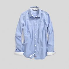 Tommy Hilfiger women's shirt. The ultimate icon of prep school chic. Tailored for a casually feminine fit, this crisp button-down shirt goes with absolutely everything in your closet. Yes, everything.• Classic fit.• 100% cotton.• Two-button cuffs, chest pocket, rounded hem.• Machine washable.• Imported.
