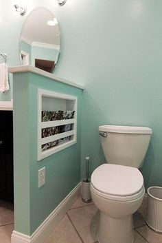 "Great idea!  Storage added to the divider   wall.  Maybe this would work with our ""bathroom island""."