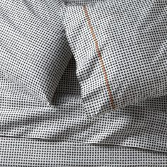Traditional block-printed fabric emerges as a new neutral, pebbled with casual polka dots that play pattern and solid with a wide range of bedding.  Hand-blocked pattern is printed on soft cotton running the full length of the sheet.  Pillows are accented with a single line of hand-embroidered chain stitch.  Sheet set includes one flat sheet, one fitted sheet and two pillowcases.  Bed pillows also available. Handcrafted100% cotton percale200-thread-countMachine wash, tumble dry lowMade in…
