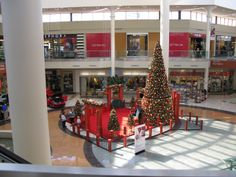 A mall in Tuscon is all decked out for Santa's arrival as a young guest anxiously looks for the jolly elf. #holidays #christmas #decor #festive