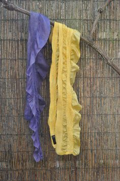nuno felted scarfs : silk + merino wool + natural dye. Left : logwood Right : tansy