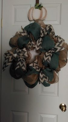 This wreath has been a crowd favorite at my events this year.  People are CRAZY about it and the color combo.  It is burlap with a teal/turquoise burlap ribbon all the way around the wreath and then a cream and gray chevron ribbon for accents.  NOTE:  ON THIS WREATH IF YOU WOULD LIKE A LAST NAME INITIAL I WILL DO THIS FOR YOU WITH WOOD.  PLEASE EMAIL ME IF YOU HAVE ORDERED THIS AND WANT THAT DONE OR JUST GIVE ME A CALL. 417-536-8982.