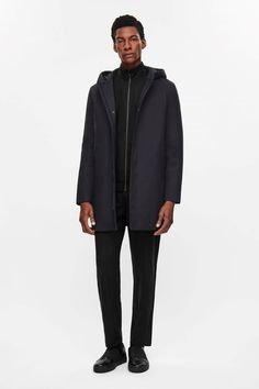 This hooded parka is made from crisp cotton-mix with a lightly padded quality and smooth silky lining. A clean straight shape with minimal detailing, it has two inside pockets, press stud front pockets and a hidden button fastening. Cos Stores, Latest Clothes For Men, Timeless Fashion, Parka, Raincoat, Bomber Jacket, Normcore, Blazer, Cotton