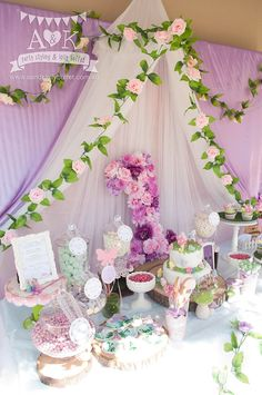 Cute for a girly purple woodland baby shower dessert table.